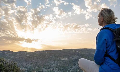 Living Trust_Woman watching sunset #ErwinLawAnswers